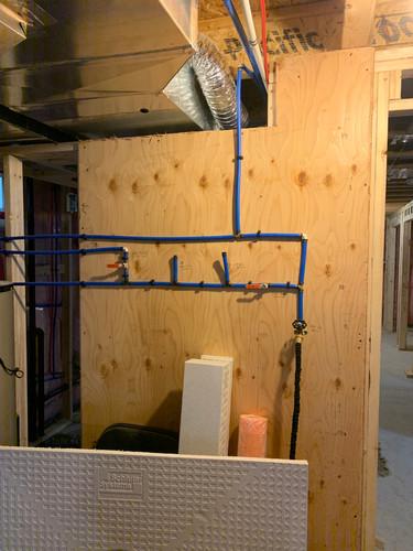 Plumbing manifold in basement