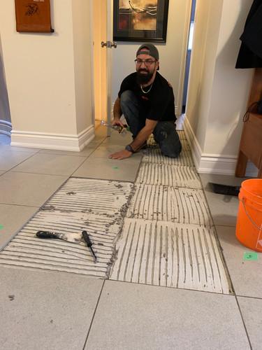 Resetting tile floor