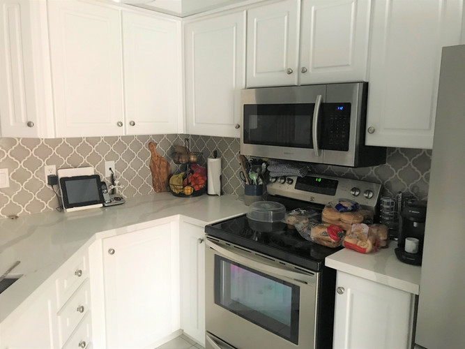 Kitchen cabinets, counter and backslpash