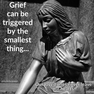 statue holding heart, grieving
