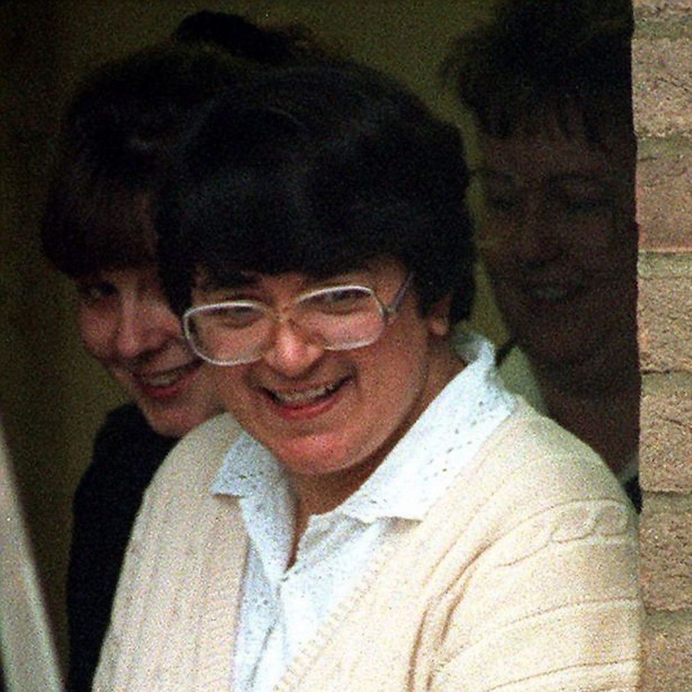 Rose West grins as she leaves court... wearing her now iconic white glasses
