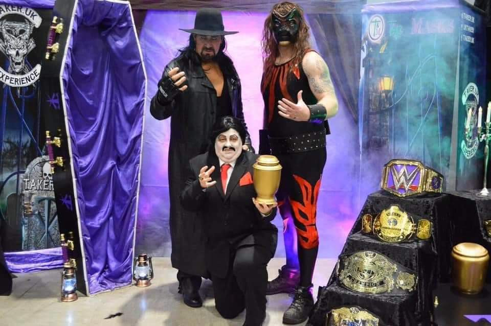 Paul Bearer with his mysterious urn, The Undertaker and his secret son, Kane