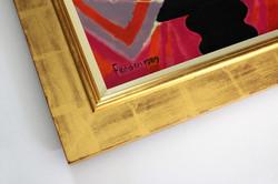 Embelished solid wood frame.