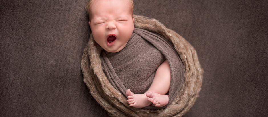 Why is it important to hire an experienced Newborn Photographer?