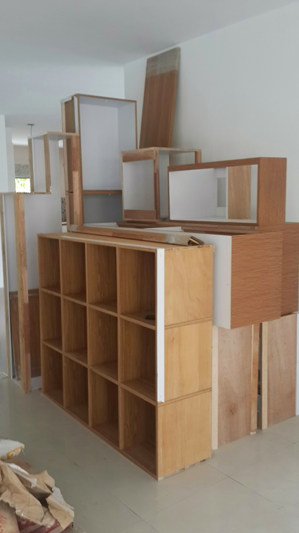Cupboards and shelves waiting for installation