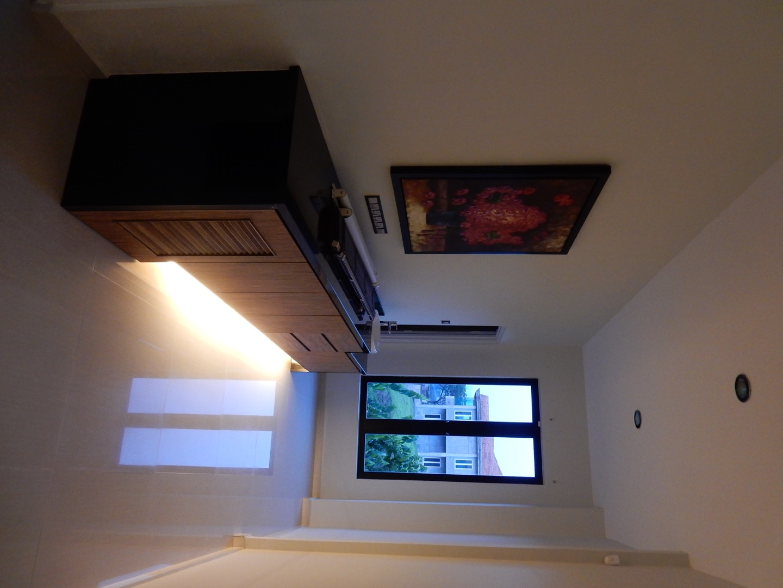 Upstairs bar with mini fridge