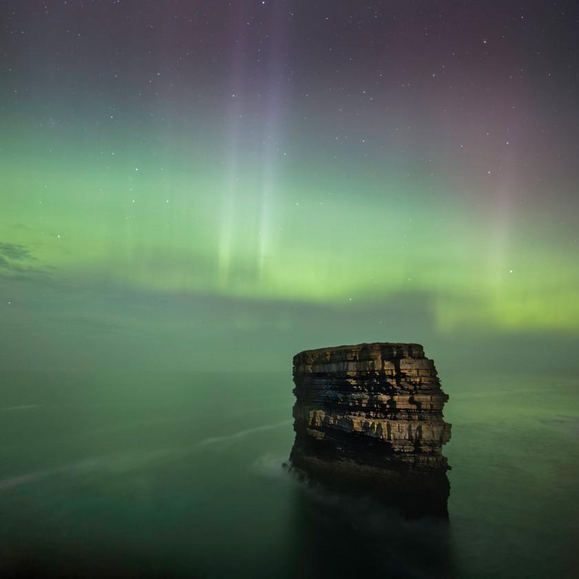 Dun Briste & Aurora Borealis - by Brian Wilson
