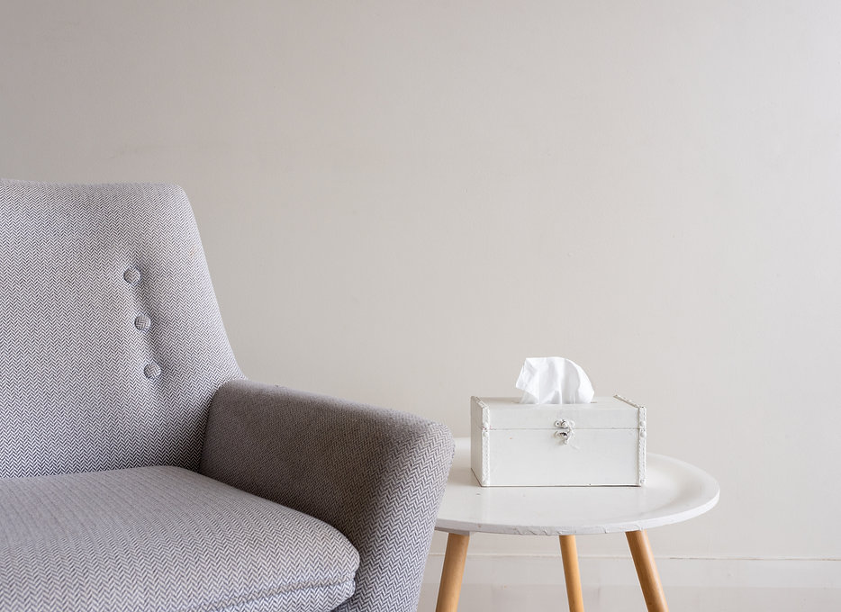 Cropped view of grey armchair with white