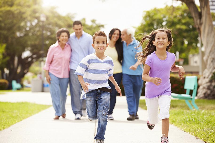 Multi Generation Family Walking In Park Together.jpg
