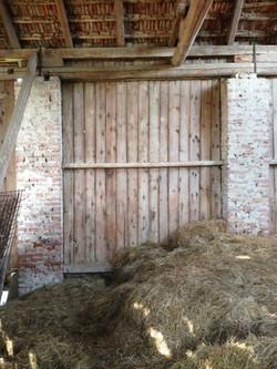 Brick and wood plank barn wall