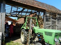 Green tractor barn crashing