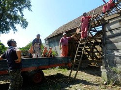 The team removing roof tiles