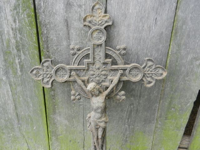 Large metal jesus on cross