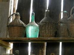 Large wine bottles with woven casing