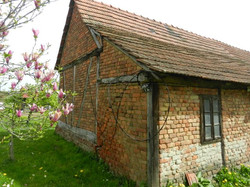 Brick house with old beams