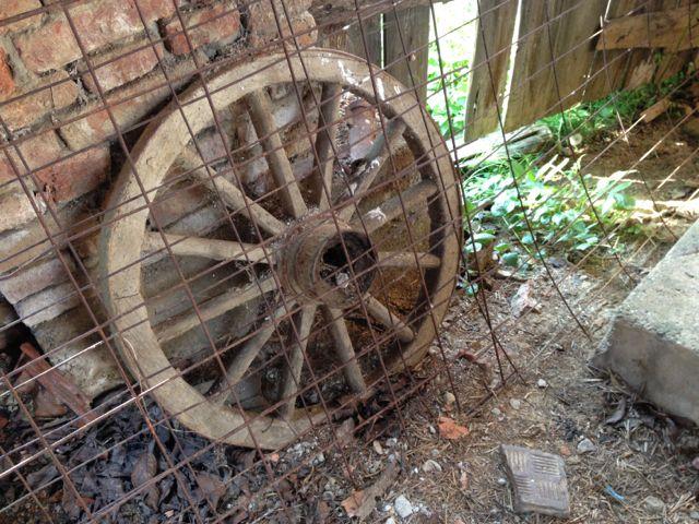 Old wood and metal cart wheel
