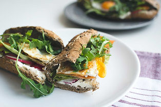 sandwich-with-eggs-and-greens-at-local-f