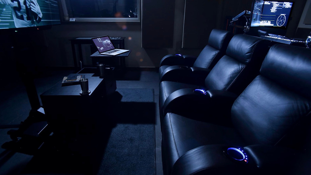Color-grading suite with theatre couches