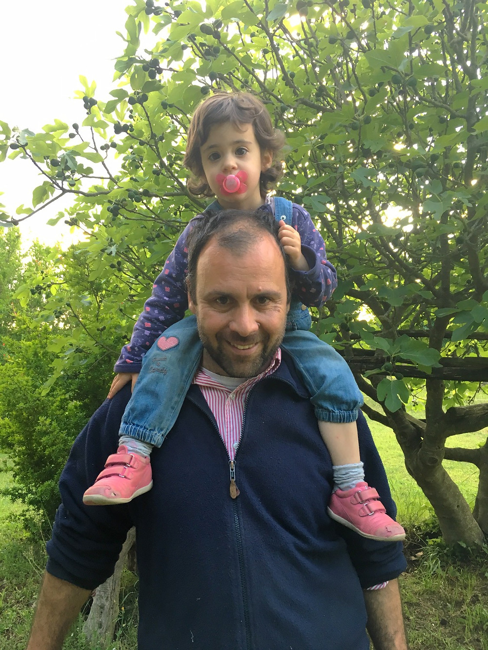 Lorenzo Caponetti with daughter on his shoulders