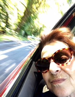 Alison on road trip, head hanging out of car window