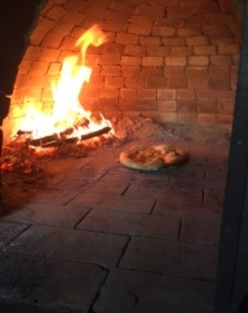 brick oven full of fire and focaccia