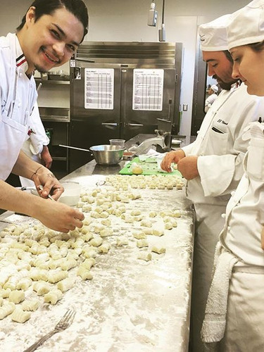 Students making gnocchi