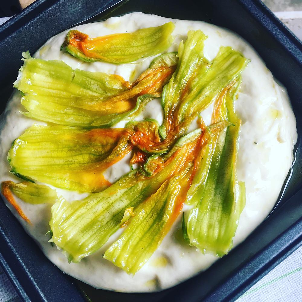 Squash blossoms on focaccia dough
