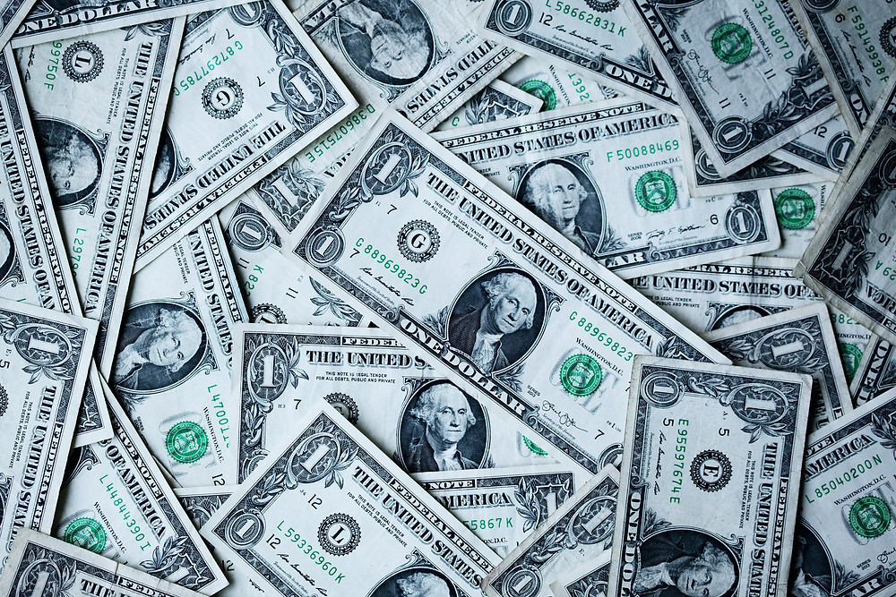 A large pile of US $1 bills. Photo by Sharon McCutcheon on Unsplash