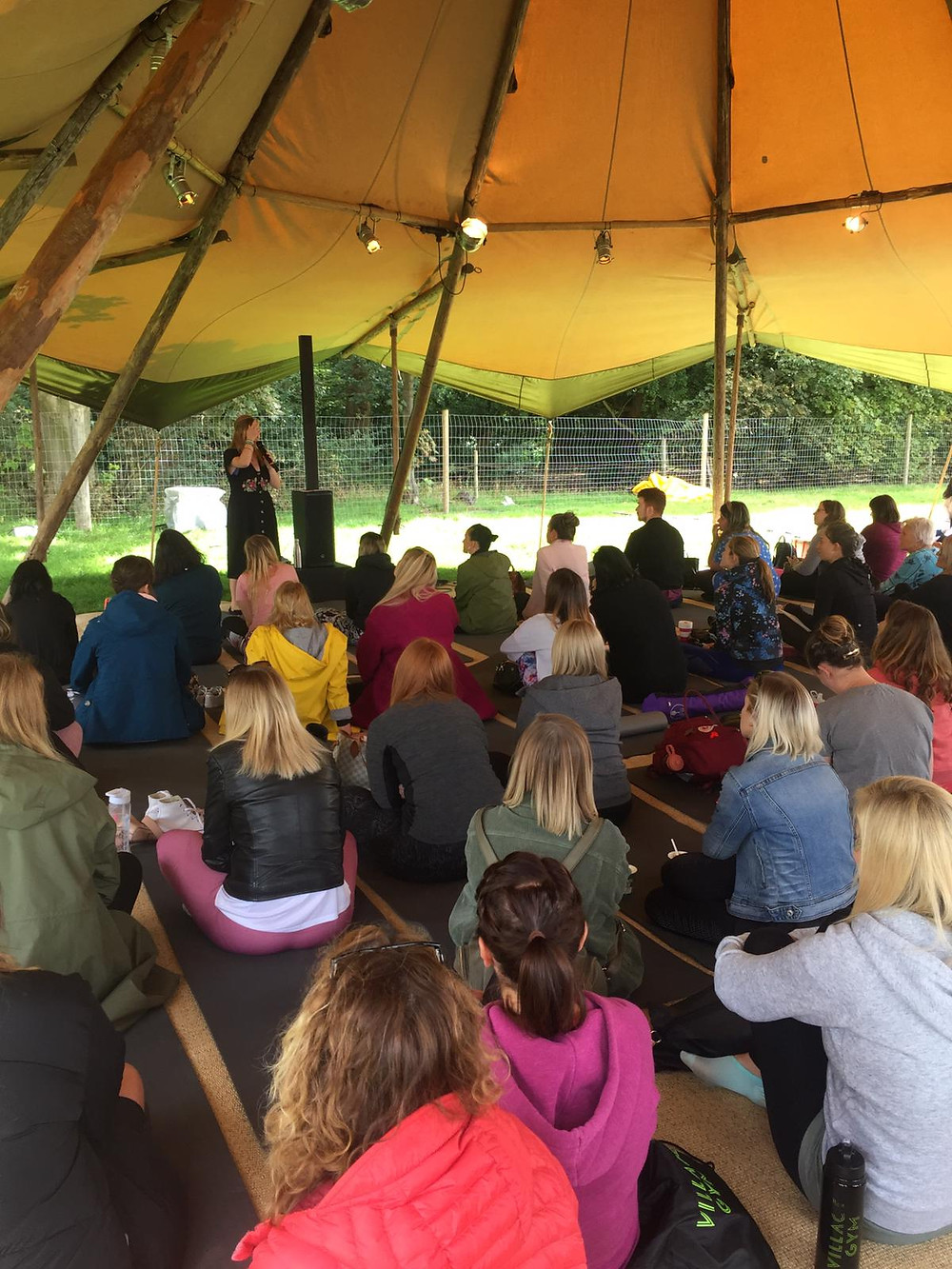 Photo of a tepee full of people listening to a workshop by Ceryn Rowntree. Photo courtesy of Rachael Morley.