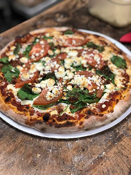 Try it! Spinach, bacon, tomatoes, and goat cheese.