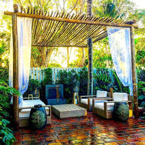 outdoor furniture surrounded with plants