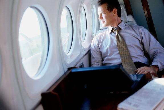 Businessman on board private jet
