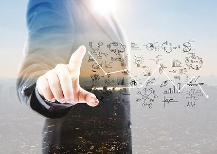 businessman-pointing-graphs-symbols.jpg