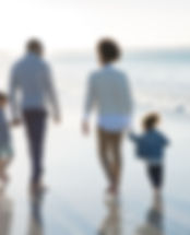 a family walking together on a beach