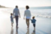 Family Walking at a Beach