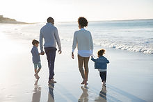 Family Walking at a Beach