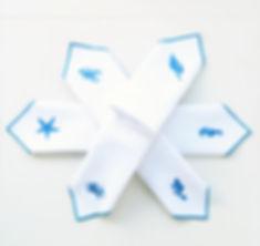 set white embroidered napkins blue sea m
