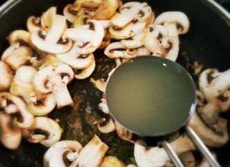 White Wine Mushroom Reduction over Angel Hair Pasta