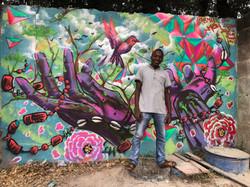 hands raised Mural Accra