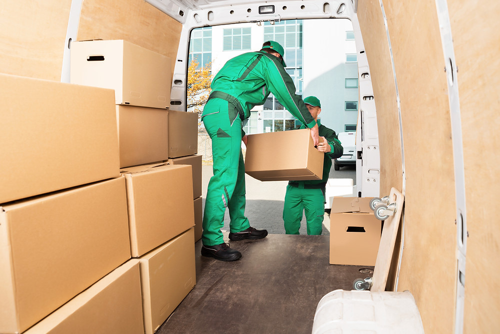 Van drivers moving boxes