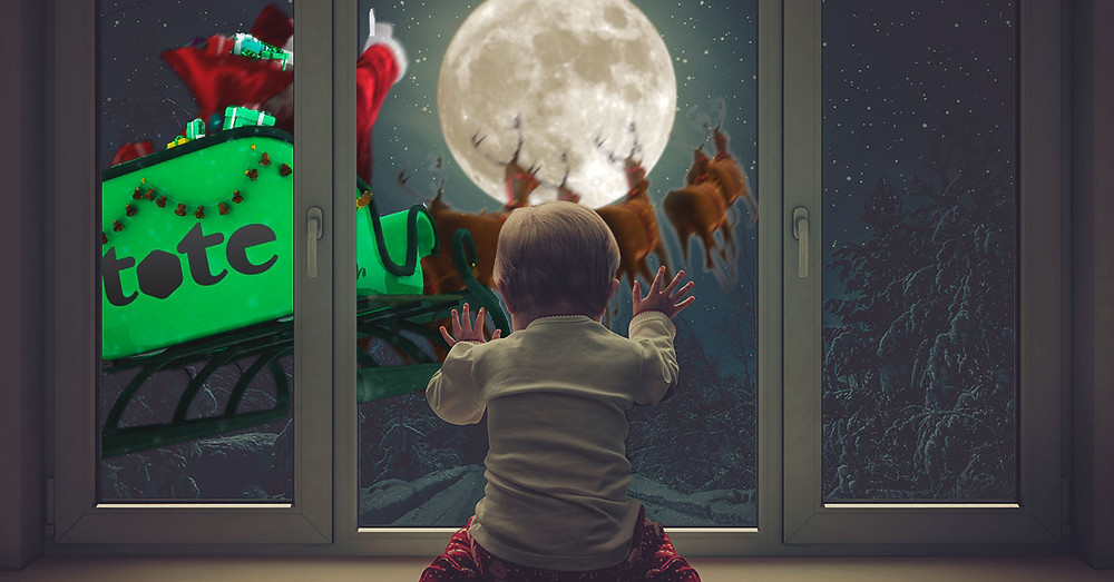 Little girl watching Santa fly by her window