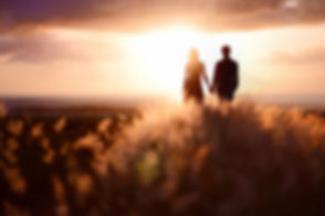 Young couple enjoying the sunset in the
