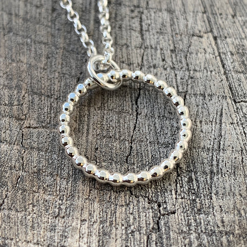 'Saturn's circle' Sterling silver hoop necklace