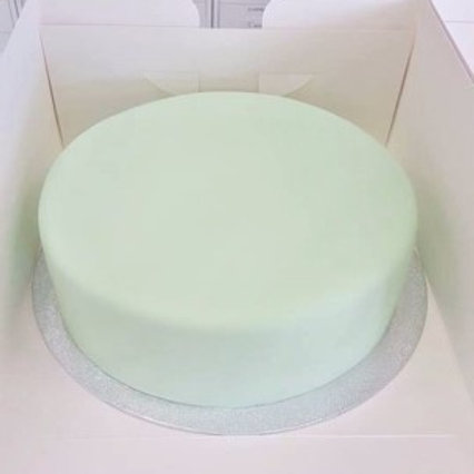 "8"" white fondant covered, chocolate flavoured cake"