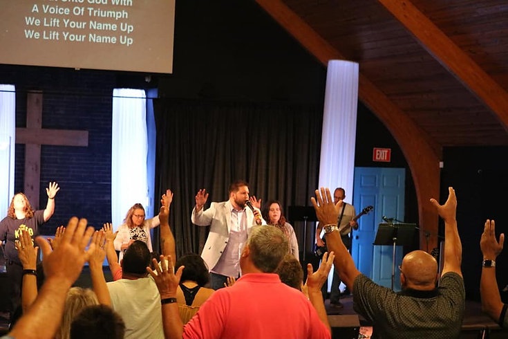 A moment of worship at a Sunday Worship Experience at Remedy Church.