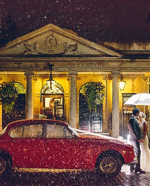 Roman Baths exterior wedding with red ca