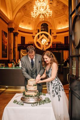 Tara &  Olly Cutting the Cake Reception