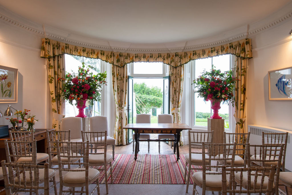 Ceremony room set up for indoor wedding ceremony at Porthpean House.