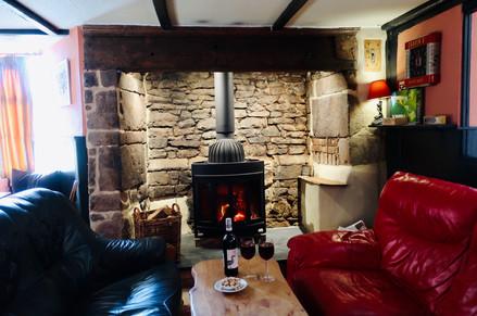 Cosy wood burner at The Lamb Inn