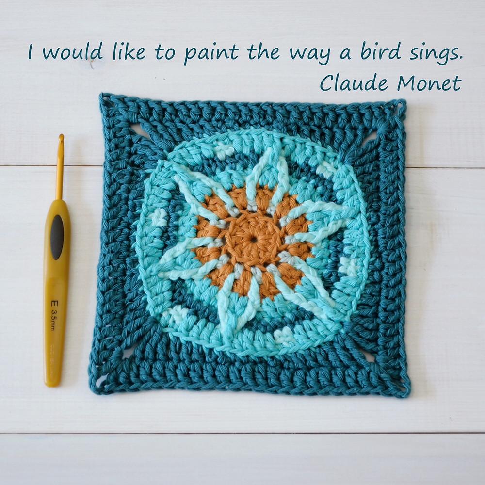 crocheted blue orange granny square